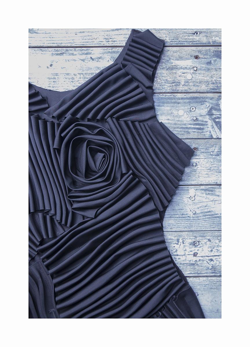 Detail: Front of 3D effect stitched flounces dress.