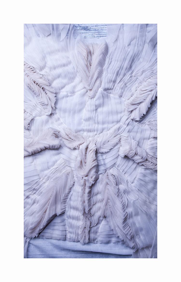 Raw-cut silk raised flounces sewn to form a design