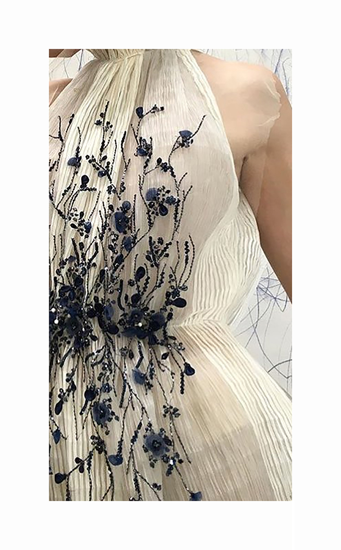 Hand embroidery on pleated garment.