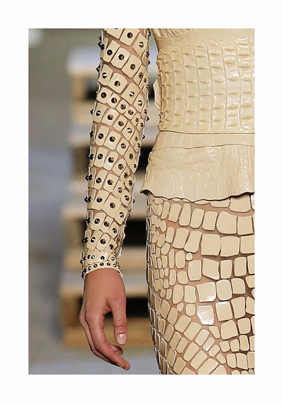 Detail: laser treated leather appliqué on stretch tulle to obtain a croc effect