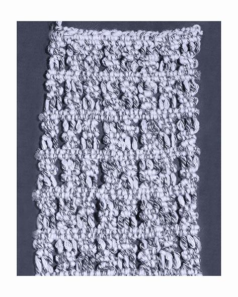 Wool macramè plaited by hand on a loom
