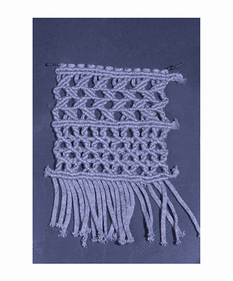 Cotton macramè plaited by hand on a loom
