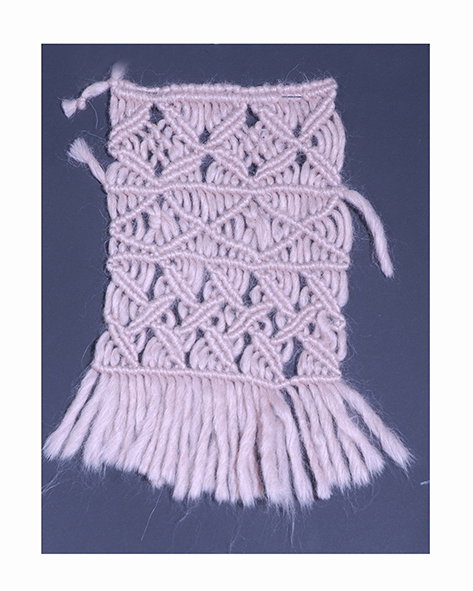 Cotton macramè plaited by hand on a loom