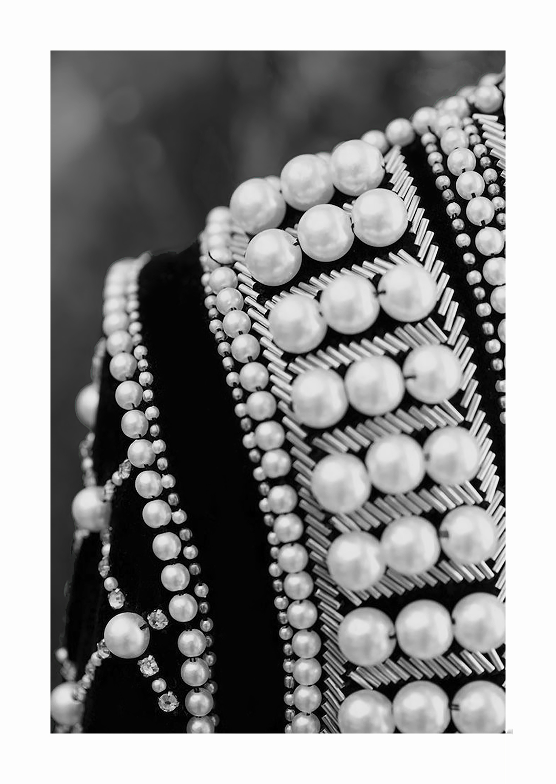 Hand seam of pearls, beads and tubes