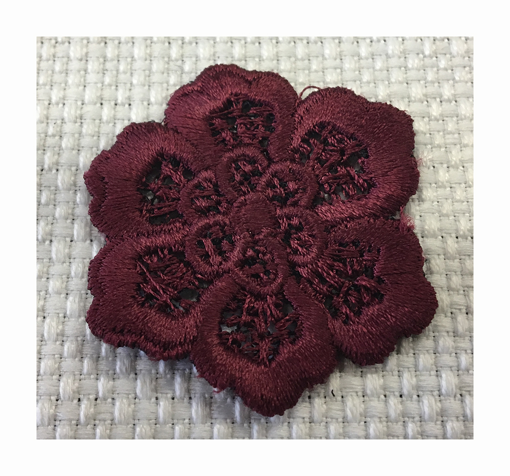 Embroidered macramè effect flower made with a contour cutting technique plus a 3D effect
