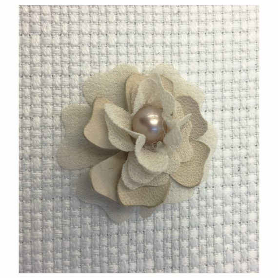 Flower made with georgette and cady petals laser treated and with a central pearl