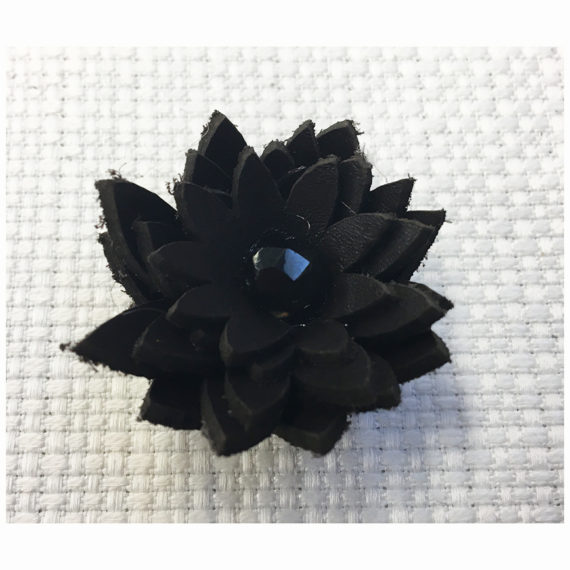 Multilayer flower made with cut leather with a central half crystal