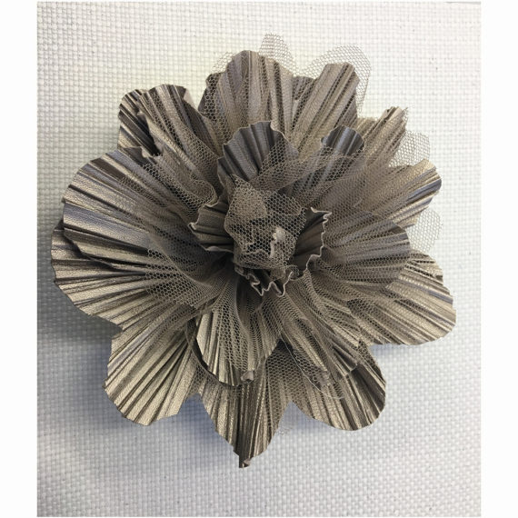 Flower made with mixed techniques : cut and pleated leather with tulle laser treated petals.