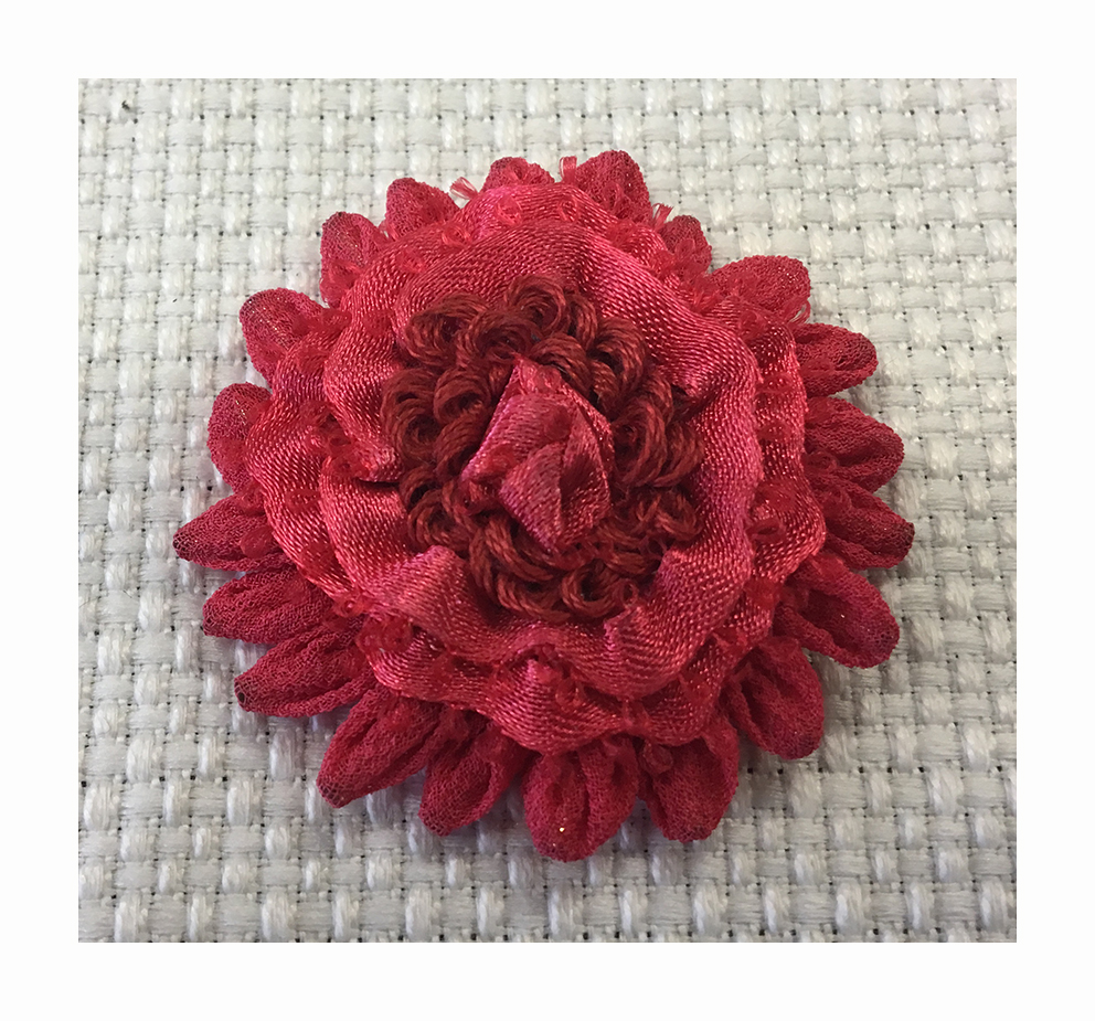 Hand- sewn flower made with different techniques