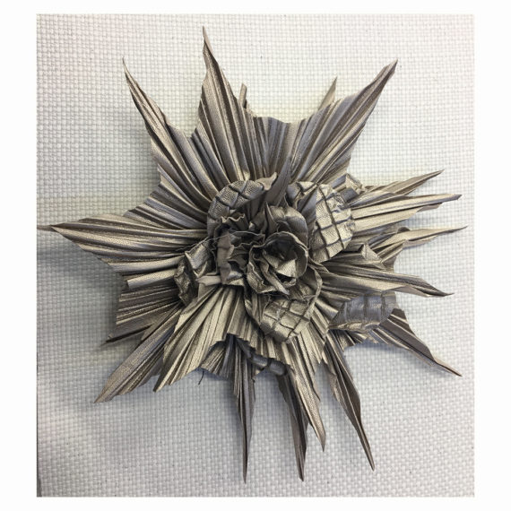 Maxi flower made in two different types of pleated leather and petals cut